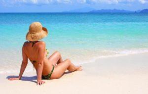 Woman Taking Beach Sun Tanning