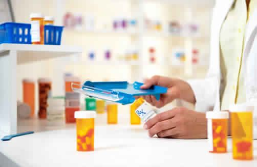 Pharmacist from an online pharmacy refills a bottle of pills